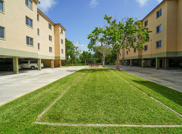 Grassy Courtyard Between Parking Lots and Building Exteriors