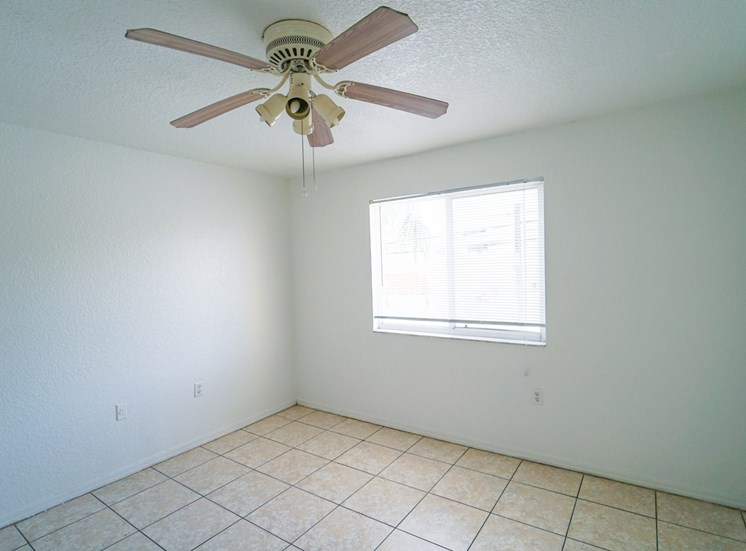 Tiled Room with Window and Ceiling Fan