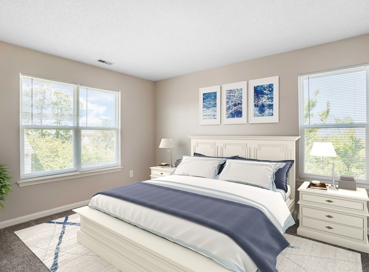 Bedroom with virtual bed with night stands and lamps.