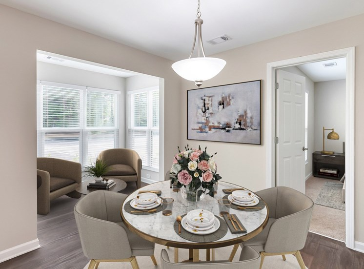 Virtual staging of  dining room with table and chairs.