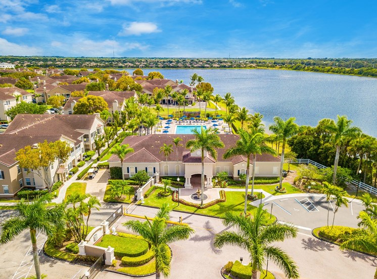 Aeriel View Over Leasing Office Exterior, Community Gated Entrance, Swimming Pool and River