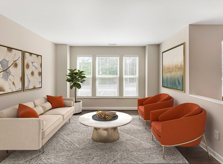 Virtual staging of living room with sofa  and arm chairs with coffee table and windows in the background.