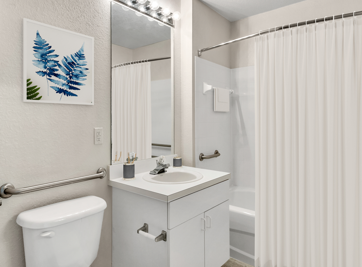 Bathroom with large mirror and vanity lighting