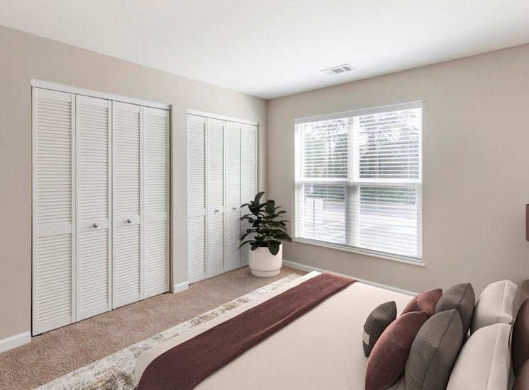 Virtual Staging of bedroom with a bed and a plant in the corner by the closet and Window.