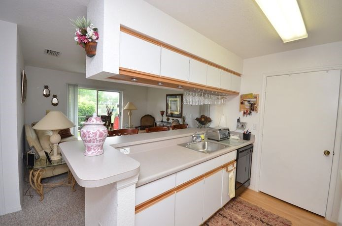 Kitchen With White Counter Tops at River Park Place Apartments, Vero Beach, 32962