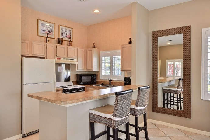 Clubhouse Kitchen With Refrigerator at River Park Place Apartments, Vero Beach, FL, 32962