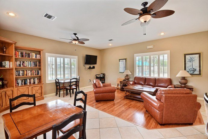 Clubhouse Interior With Large Leather Couch, Bookshelf at River Park Place Apartments, Florida, 32962