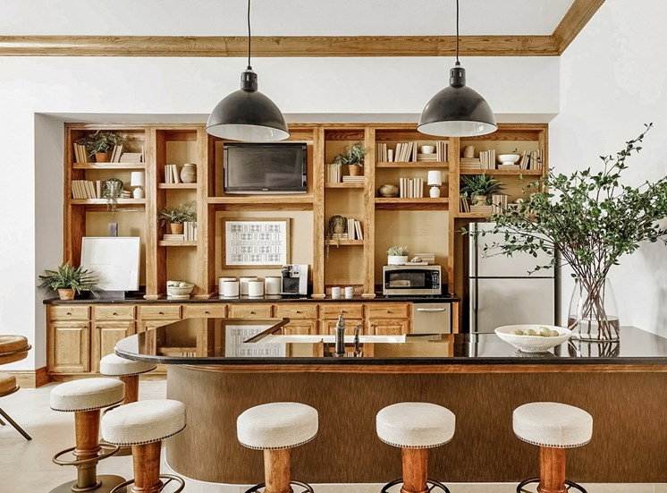 Clubhouse kitchen with bar stool chairs by the breakfast bar.