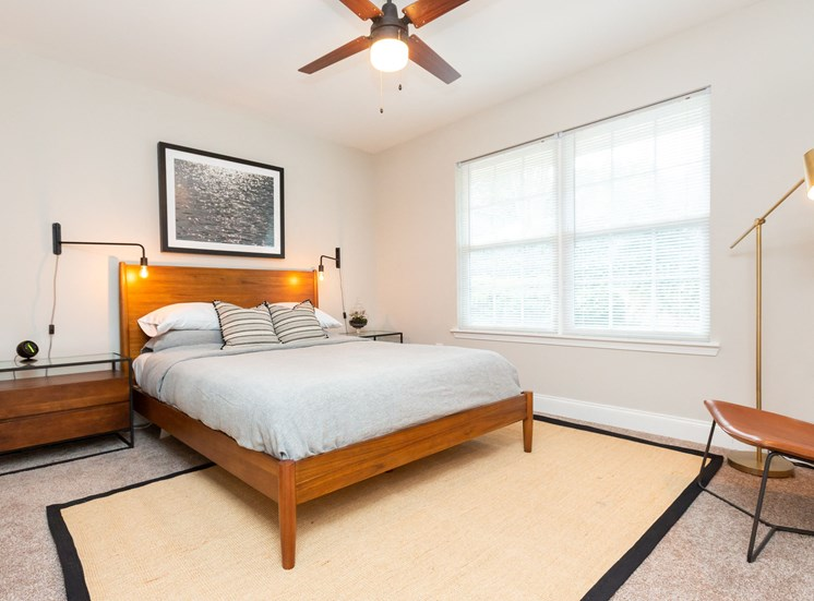 Furnished Model Bedroom with Contemporary Decorations Bed Chair and Nightstand