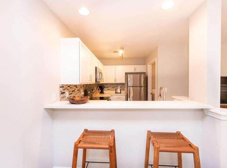 Furnished Model Kitchen and Breakfast Bar with Bar Stools