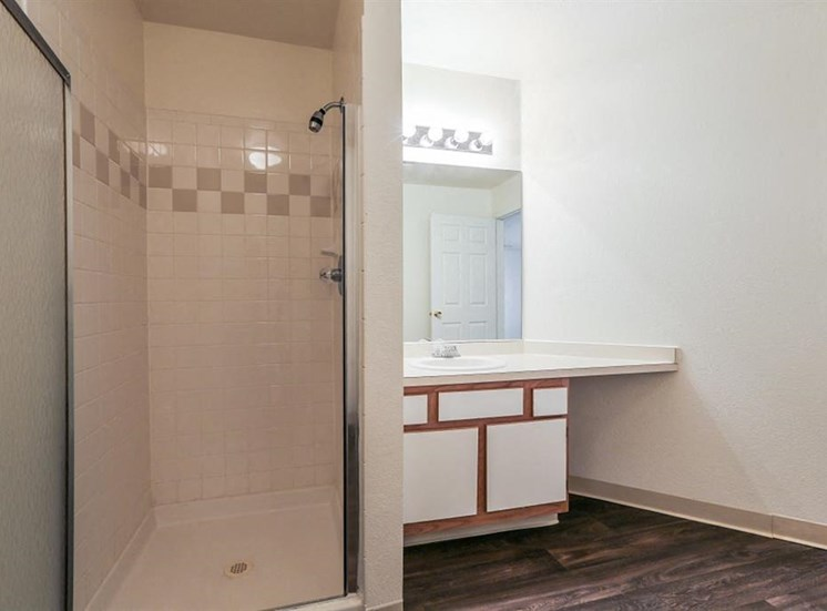 Bathroom with Walk in Shower and White Cabinets with Wood Accents