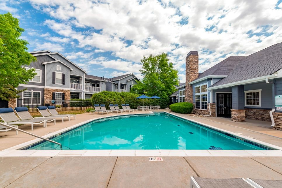 Swimming Pool and Sundeck with Lounge Chairs and Building Exteriors