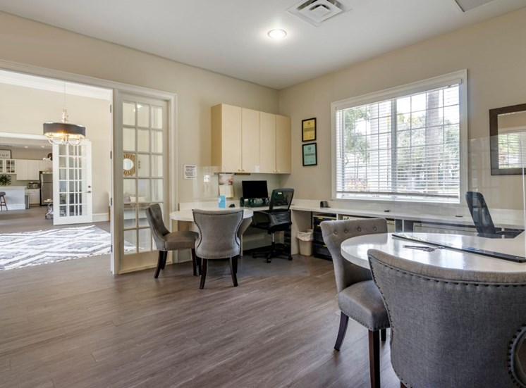 Clubhouse lounge and leasing center with large window for natural lighting