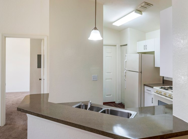 Kitchen with breakfast bar and pendant lighting