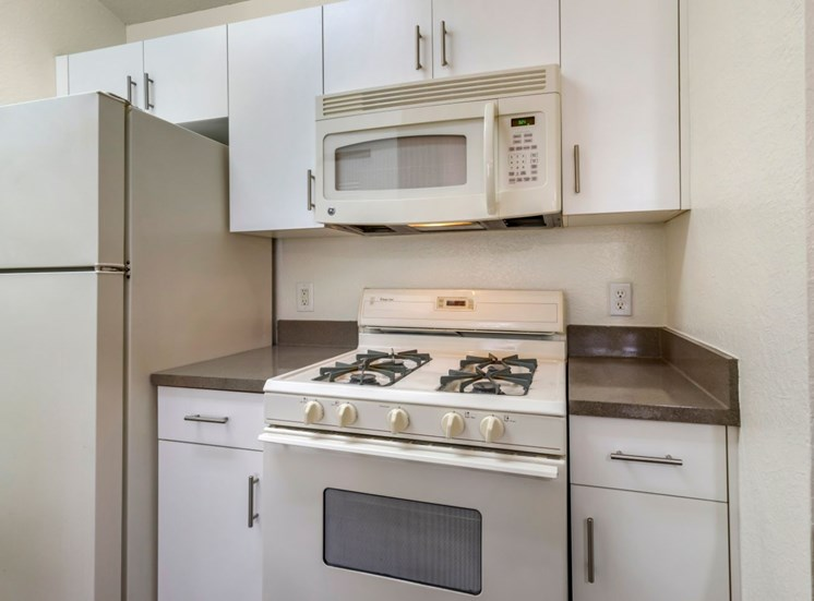 Fully equipped kitchen with white appliances and white appliances