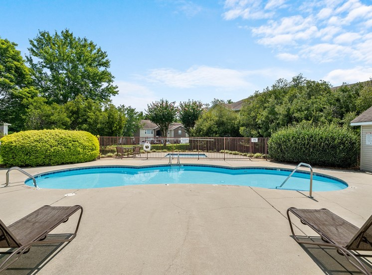 Swimming pool with lounge chairs, tanning deck and