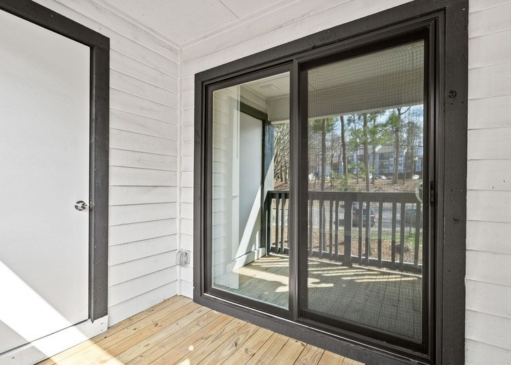 View of outdoor balcony with black trim and white paint