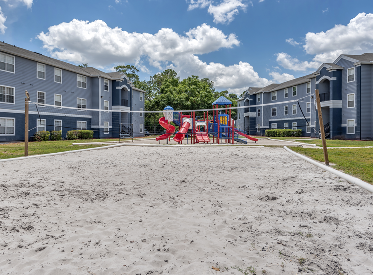 Outdoor sand volleyball court and playground