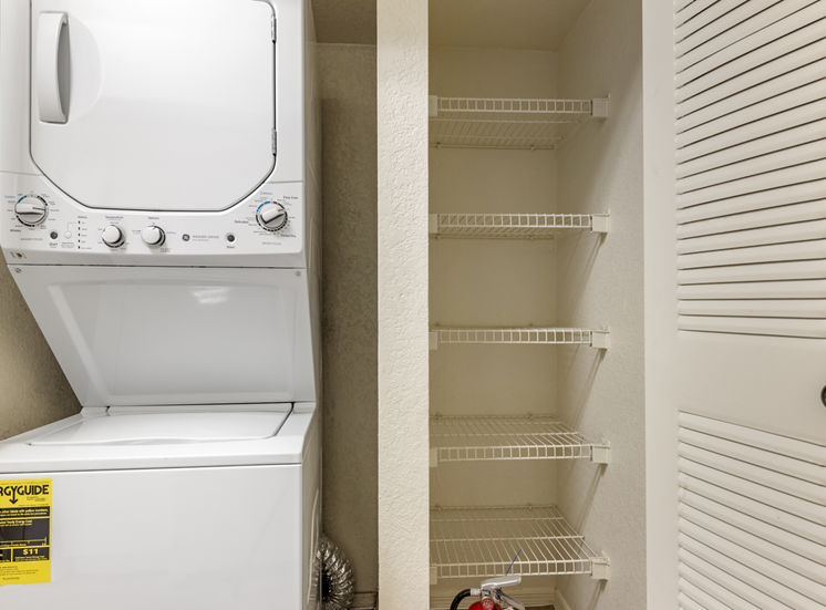 Stackable washer and dryer with linen closet