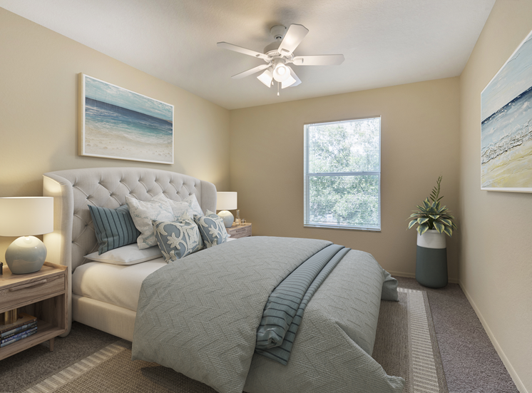 Furnished bedroom with wall art, night stands, bed, floor rug, multi speed ceiling fan, and large window for natural lighting