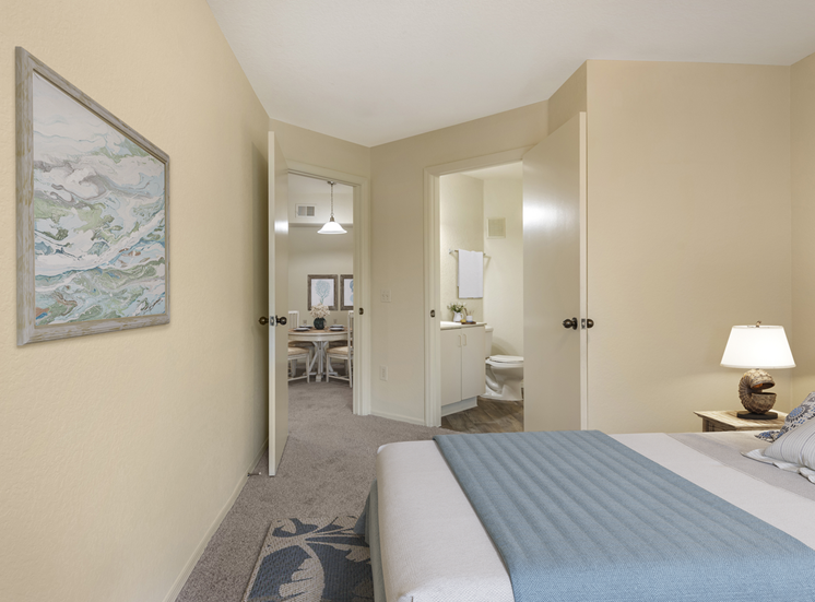 Furnished bedroom with carpet flooring and en-suite bathroom