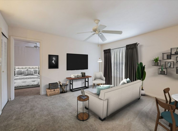 Carpeted Living Room with Virtually Staged Couch, Entertainment Center and Decorations