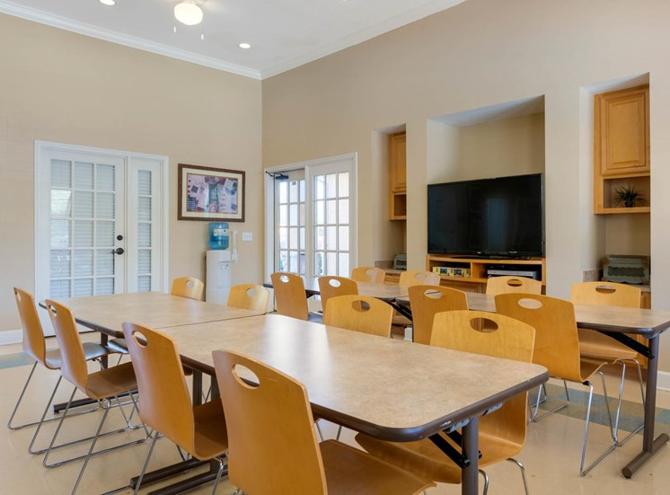 Resident Event and Recreation Room in Clubhouse with tables and chairs, and tv