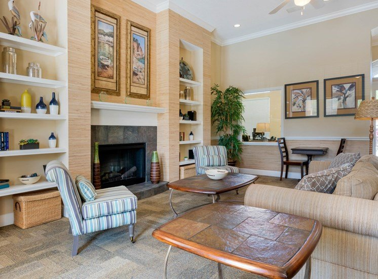 Club house lounge with couches, coffee table and rug