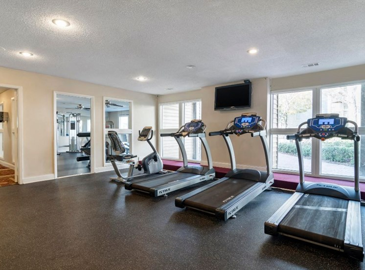 Fitness Center with Exercise Equipment in Front of Mirrors