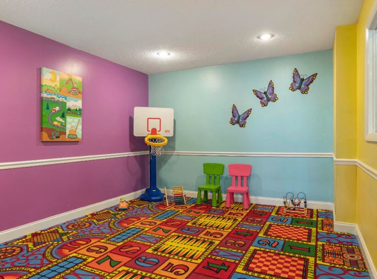 Colorful Activity Center with Toy Basketball Hoop  and Art on the Walls