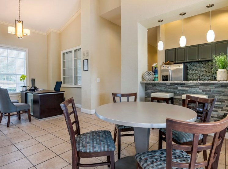 Clubhouse kitchen with breakfast bar and cafe style seating