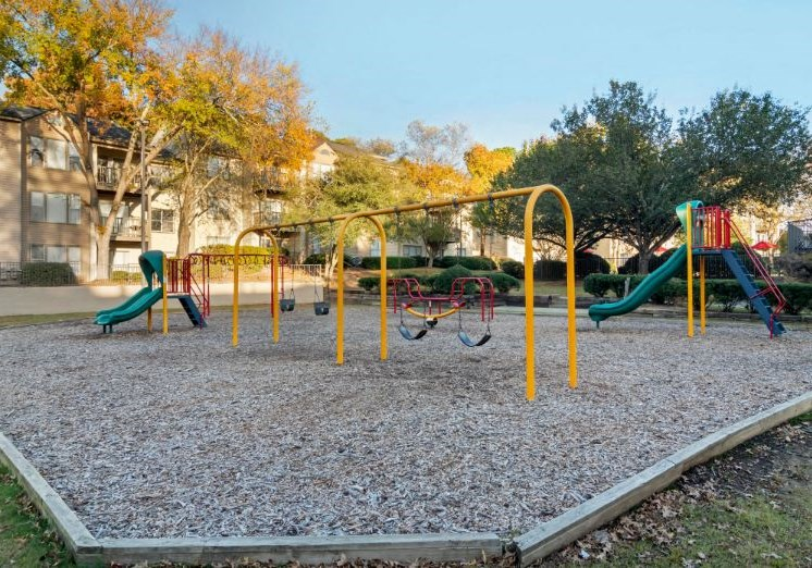 Colorful Playground with Swing Set on Mulch