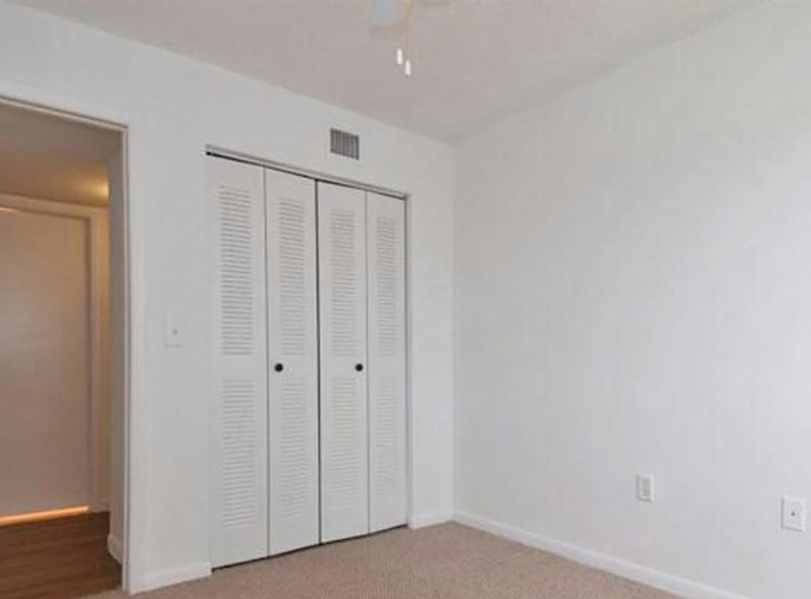 Carpeted Bedroom with Sliding Closet