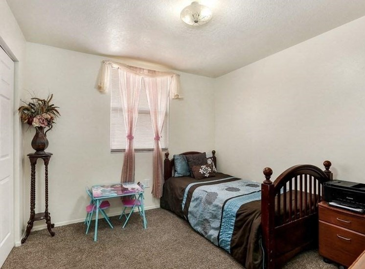 Model bedroom with twin bed and nightstand