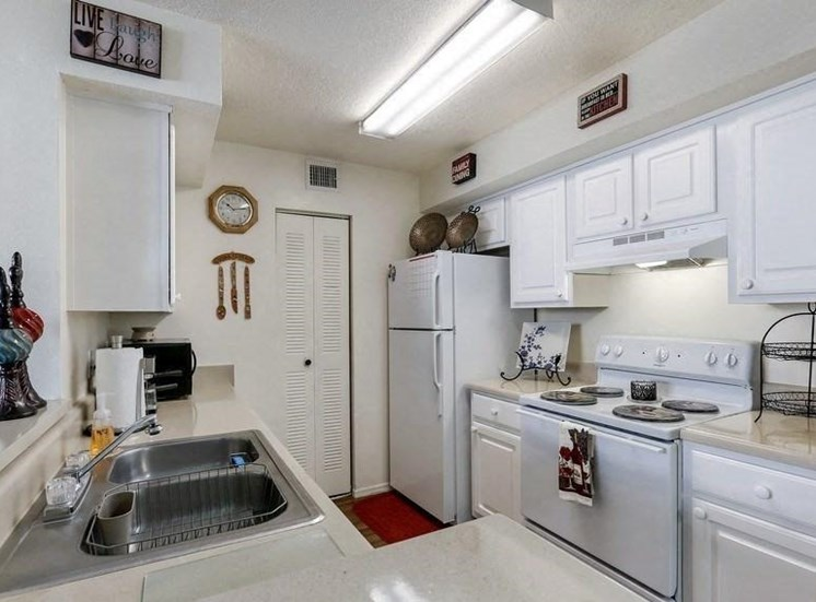 Kitchen model with white cabinets and white appliances