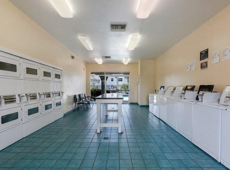 Laundry care facility with folding table