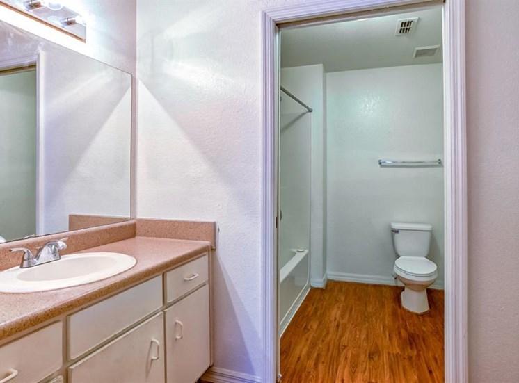 Bathroom with Hardwood Style Flooring