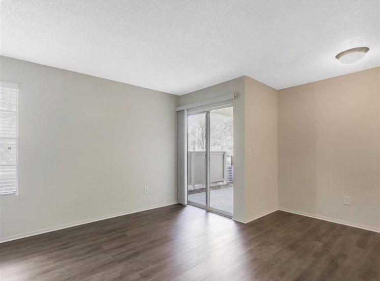 Living Room with Hardwood Style Floor and Sliding Glass Patio Door