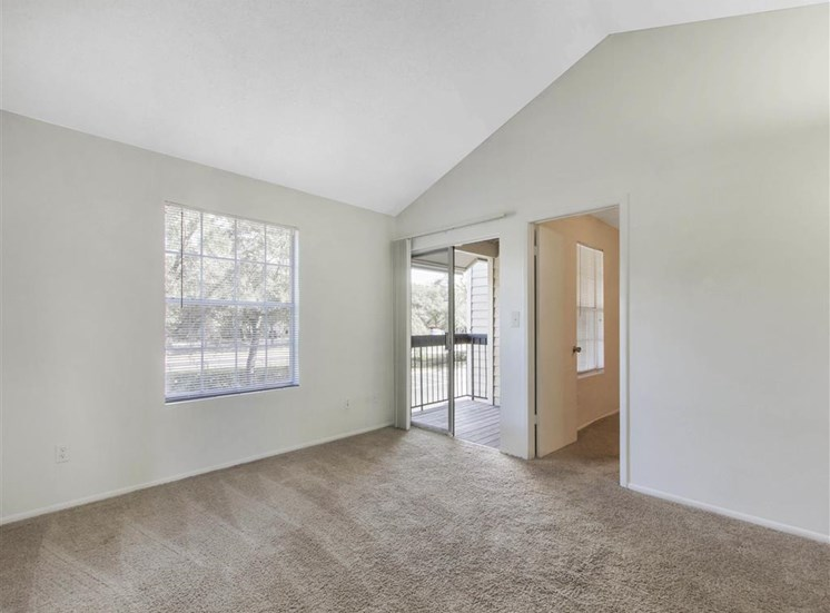 Carpeted Living Room with Sliding Glass Patio Door