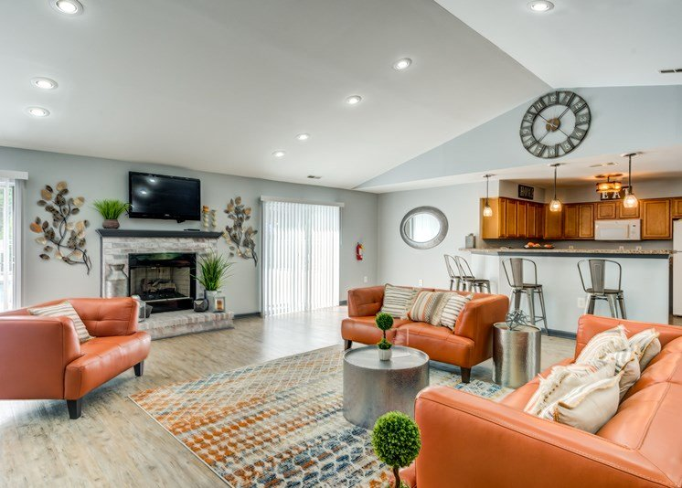Clubhouse interior with vaulted ceilings, hardwood style flooring, and a colorful rug