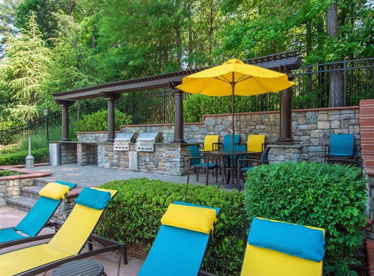 Poolside Lounge Seating with Summer Kitchen in the Background