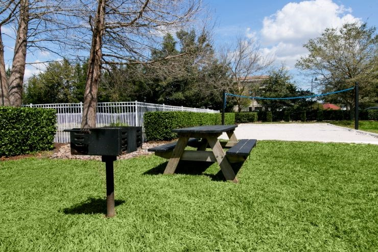 Outdoor grill station with picnic table seating