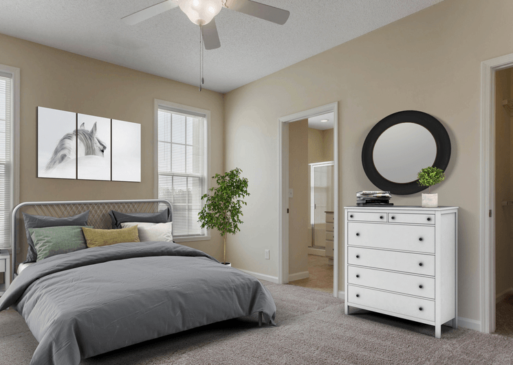 Virtual rendering of bedroom with white dresser, decorative mirror, bed with gray linens, and a window