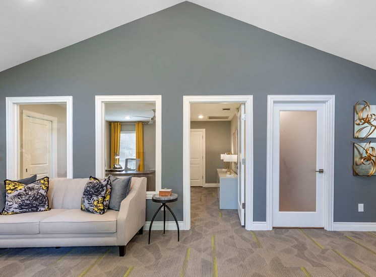 Clubhouse Seating Are with White Couch Against Blue Accent Wall