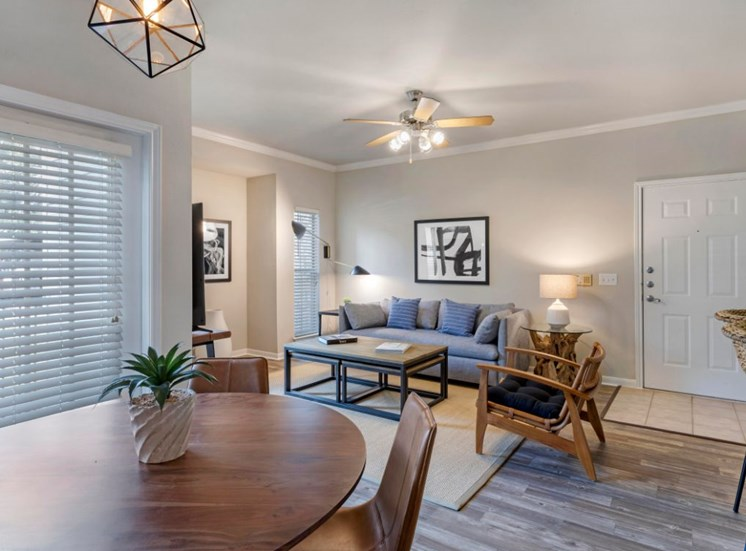 Model Dining Room with Dining Table Next to Living Room with Contemporary Furniture