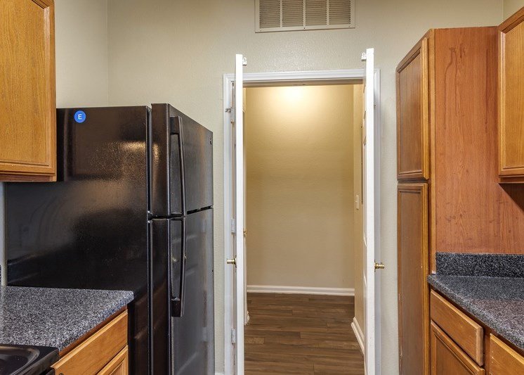 Fully equipped kitchen with black appliances and French doors