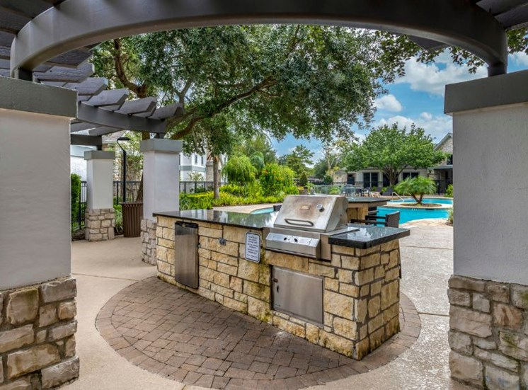 Poolside gas grilling station with bar top seating