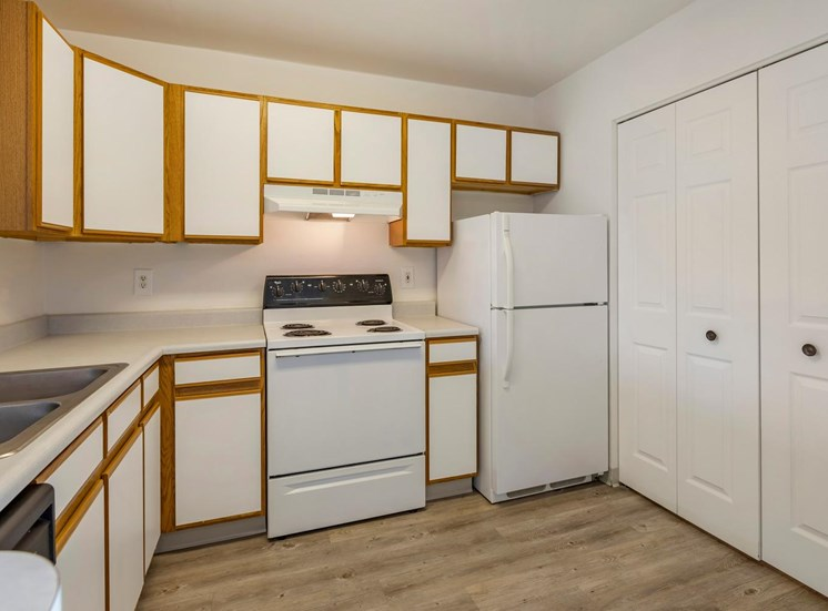 Kitchen with white appliances and white countertops.