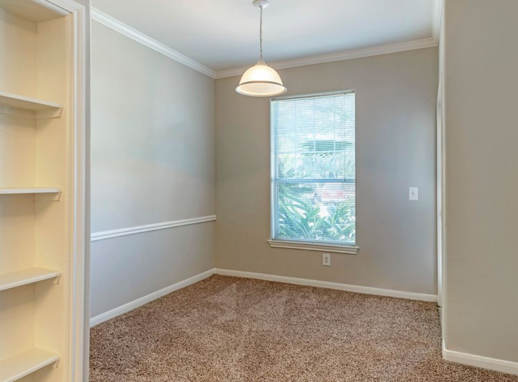 Dining room with gray walls and built in storage unit