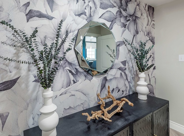 Leasing Office Decorative Wallpaper with Accent Mirror and Small Table